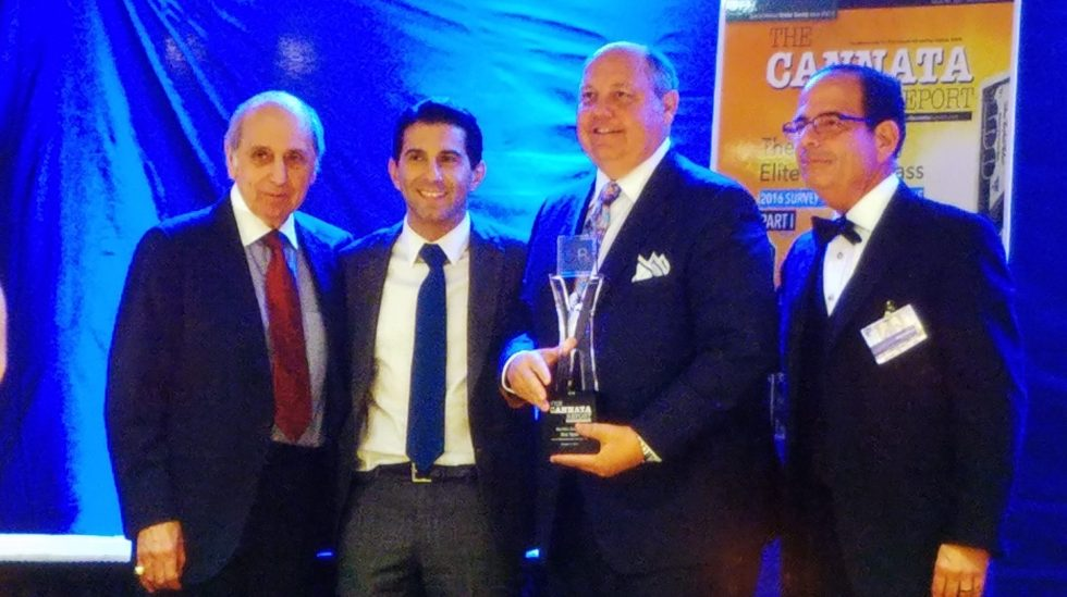 Best Male Executive Rick Taylor of Konica Minolta receives his award from Frank & CJ Cannata and Bob Goldberg.